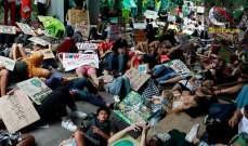 صورة مظاهرات في إندونيسيا وألمانيا وتايلاند وأستراليا للحفاظ على البيئة
